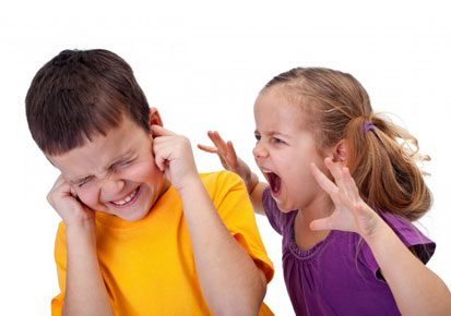 A girl shouting at a boy
