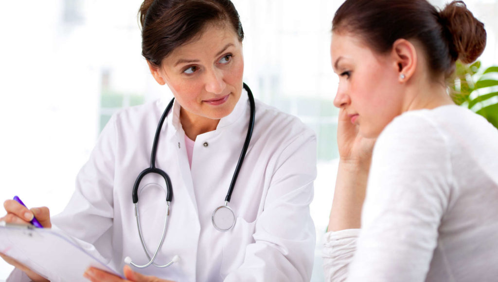 medical advice female doctor and woman