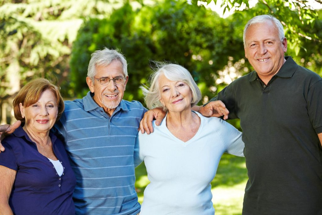 two old couples hands over shoulder