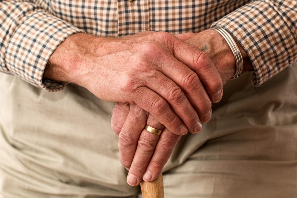 Aged man holding a cane