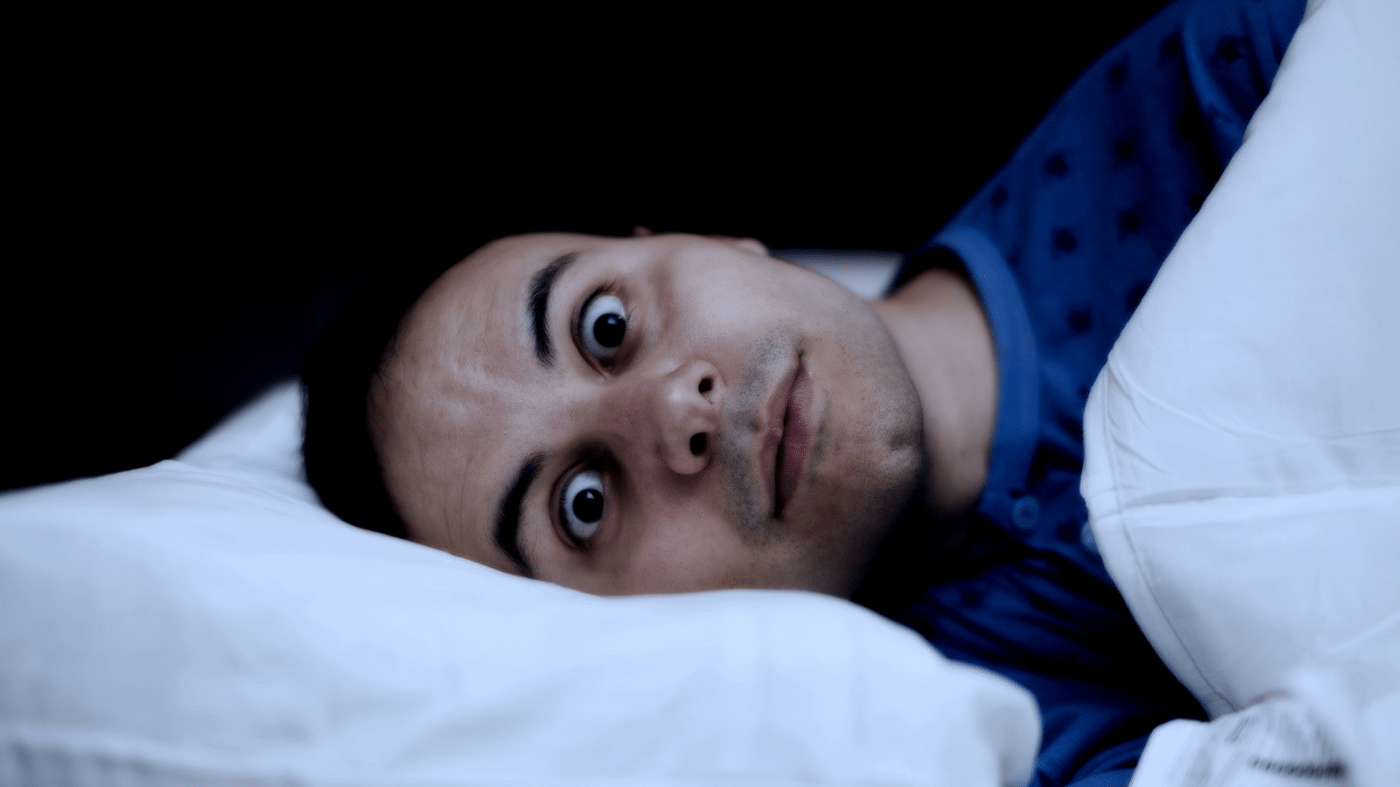 man unable to sleep eyes wide open insomnia