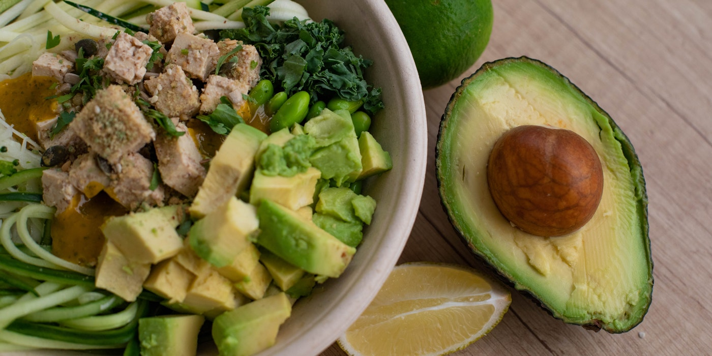 a plate of salad with avocado