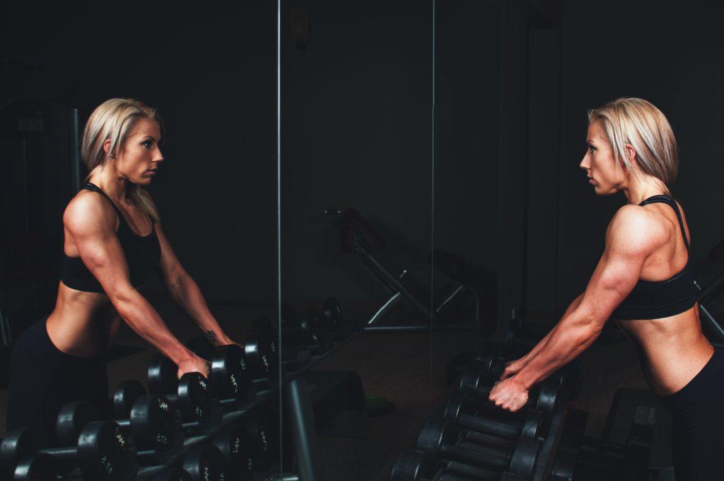 Woman at gym, exercising.