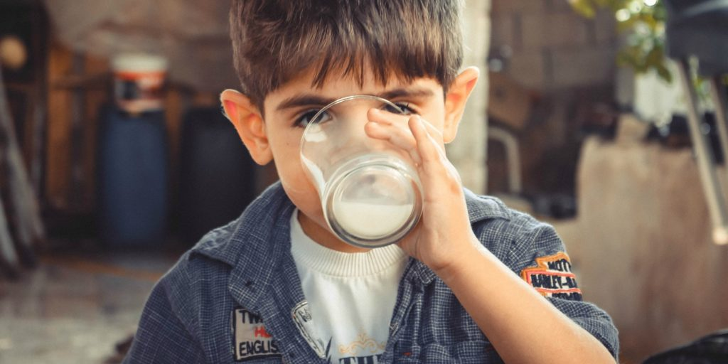 A boy drinking buttermilk