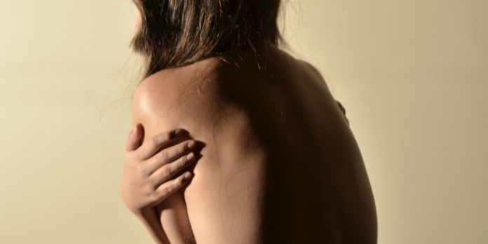 A woman with back pain