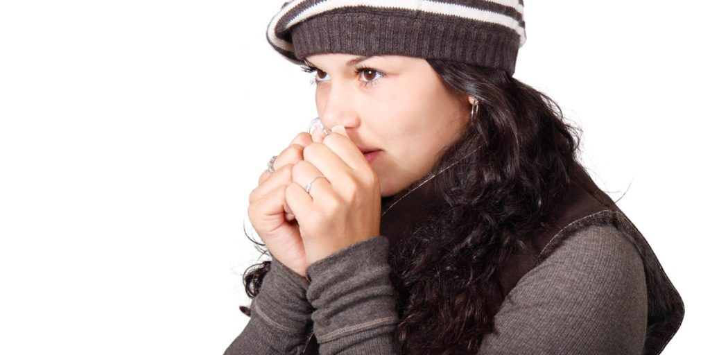 A woman who suffers a cold