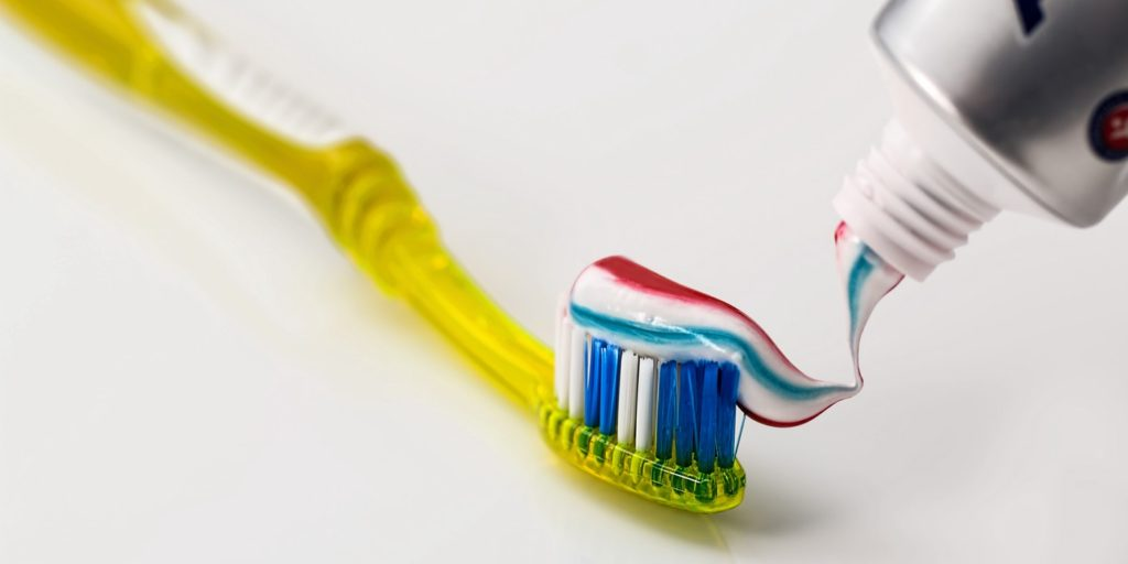 A picture of toothbrush and toothpaste