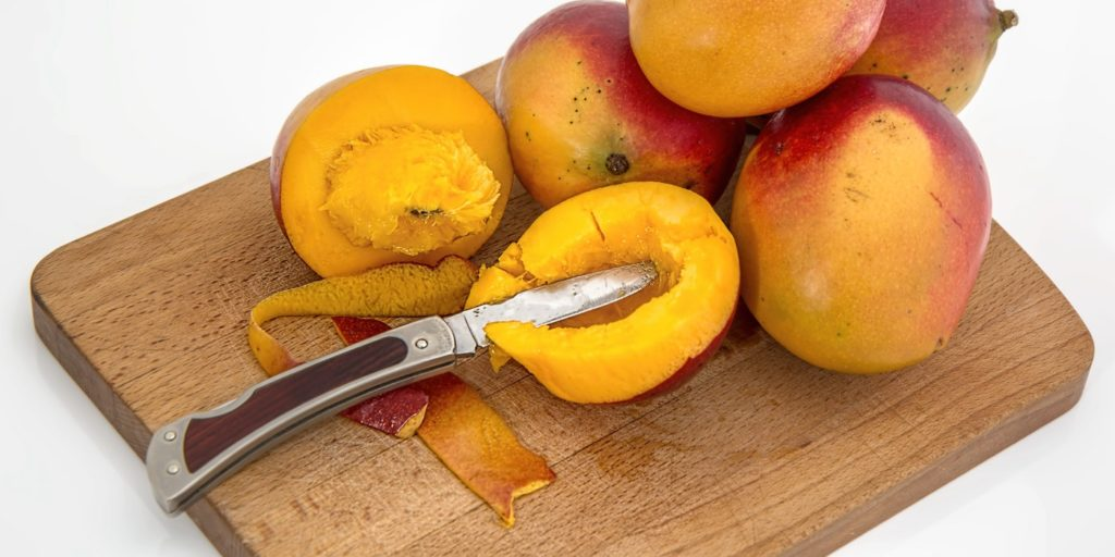 Mangoes on a chopping board