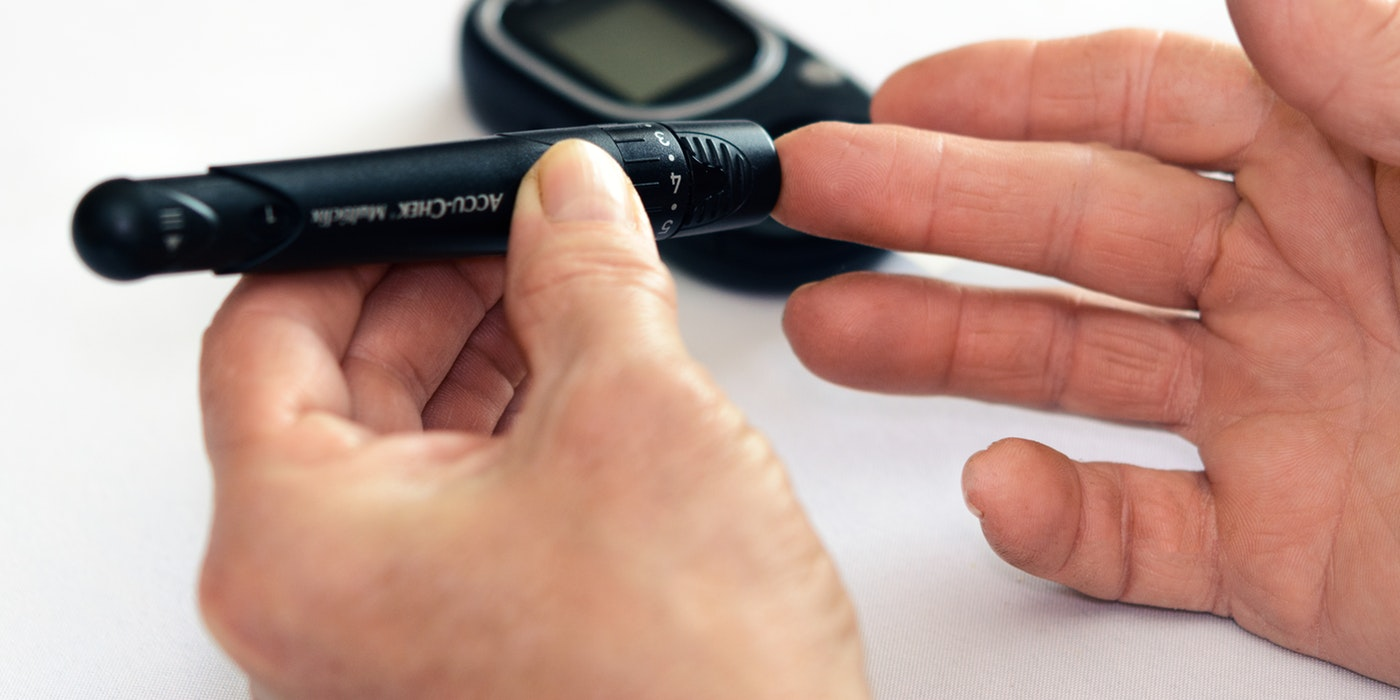 An image of someone testing for blood sugar