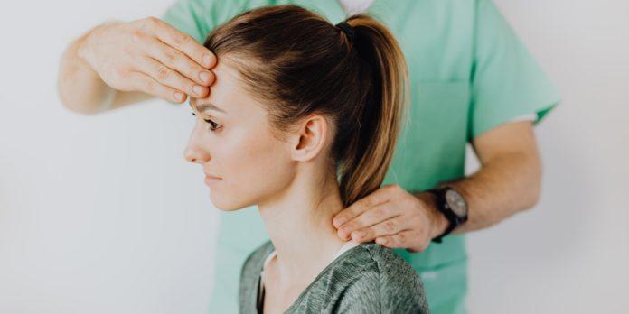 Therapist massaging patient